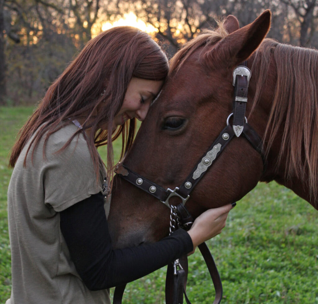 Young woman in horse therapy