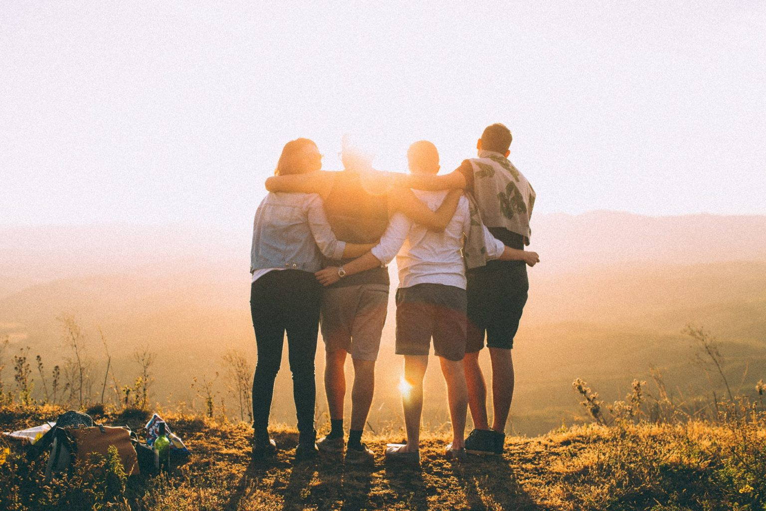 Group of people looking at sunset
