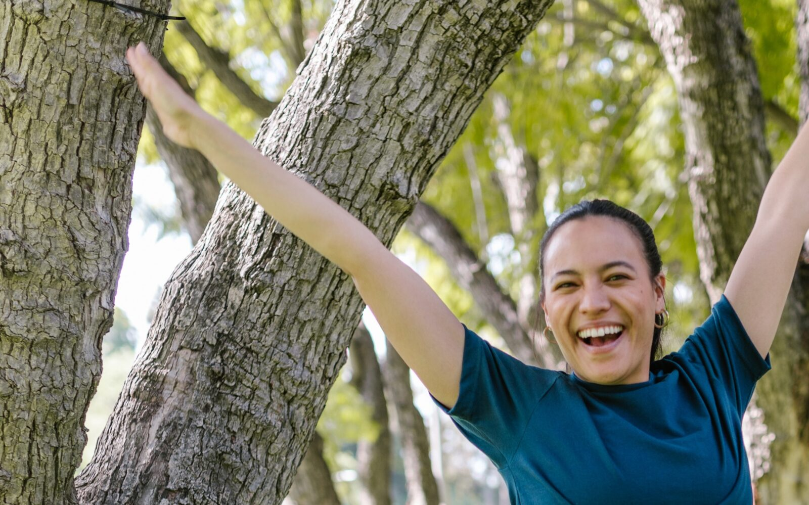happy woman in trees