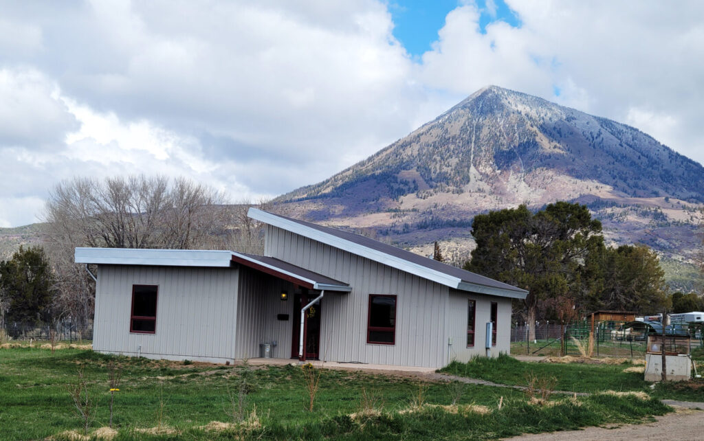 Landsend mountain in the background of a residential therapy house