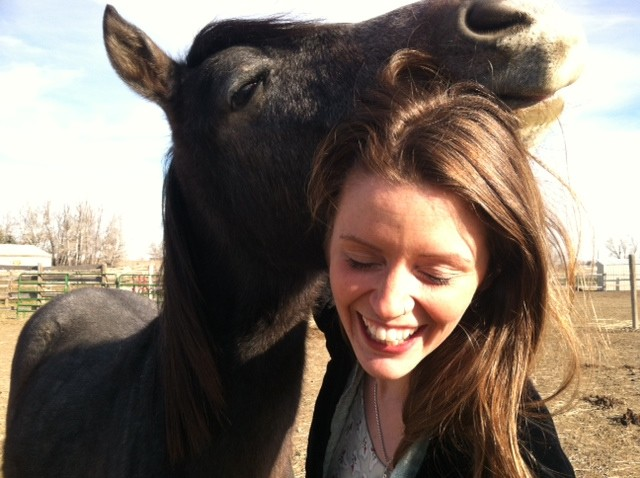 happy woman with a horse